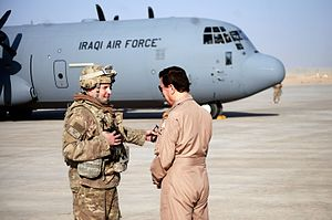 U.S._Air_Force_Col._Rhett_Champagne_speaks_with_the_chief_of_staff_of_the_Iraqi_air_force_at_Q-West_Airfield